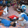 Giving first aid during mock earthquake drill at primary school, Lamonirhat District, Bangladesh.  Photo: Plan International